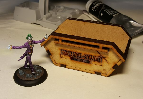 Knight Models Batman Miniature Game Joker standing next to TT Combats Refuse Skip.
