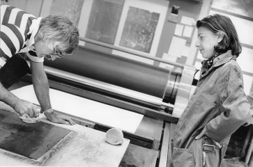 Helen Frankenthaler observing Kenneth Tyler inking 'Essence Mulberry' woodblock on Mailander offset proofing press in workshop, Tyler Graphics Ltd., Bedford Village, New York, 1977. Photo: Lindsay Green