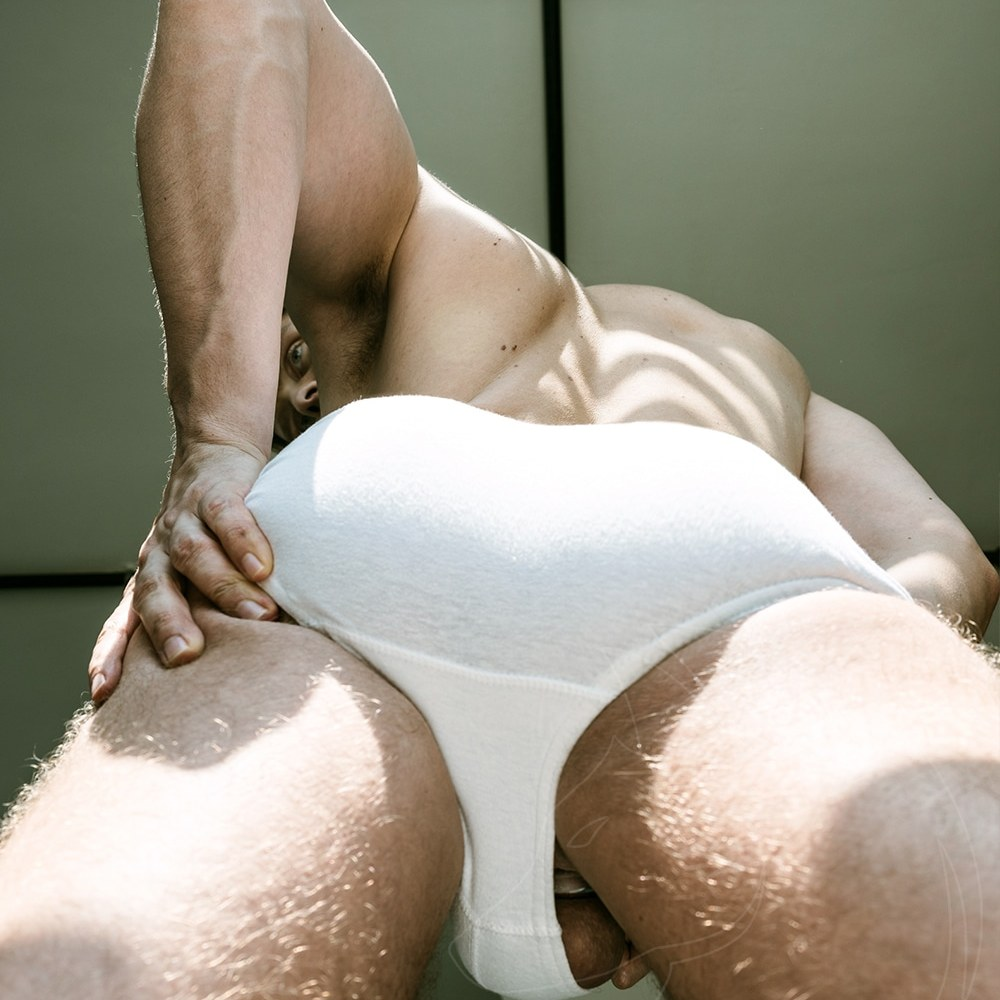 male underwear model, side ball, upshort with cockring