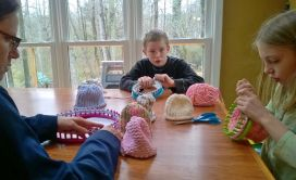 Julia and Evan knitted dozens of hats for Kenyan newborns 2 years ago.