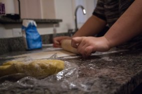 Sophia Horen, 21, rolls dough to prepare ravioli on Sunday Feb. 19,2017. (Photo by Tynin Fries)