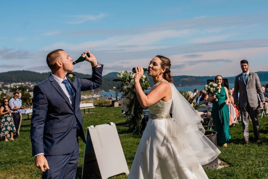 champagne toast to bride and groom after walking down the aisle at outdoor wedding ceremony