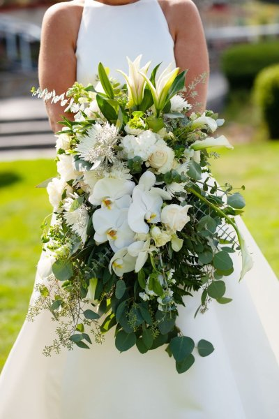 green and white wedding flowers, cascading bouquet, cascade bouquet, lilies, orchid, roses, eucalyptus, greens, ferns, calla lily, large wedding bouquet