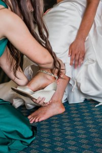 putting on bride's shoes, badgley mischka shoes, beaded wedding shoes, wedges wedding shoes