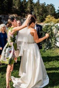putting fingertip horsehair veil on bride and outdoor Pacific Northwest wedding