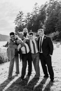 must have wedding shot list, silly groomsmen photos at an outdoor Pacific Northwest wedding on the beach