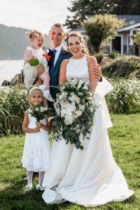 Pacific Northwest wedding portraits, bride and groom with flower girl, beach outdoor wedding