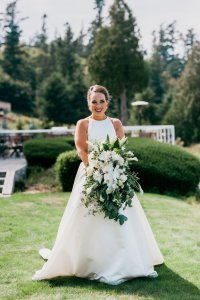 smiling bridal portrait, green and white wedding flowers, classic a line wedding dress, high neckline wedding dress, Pacific Northwest wedding portrait ideas