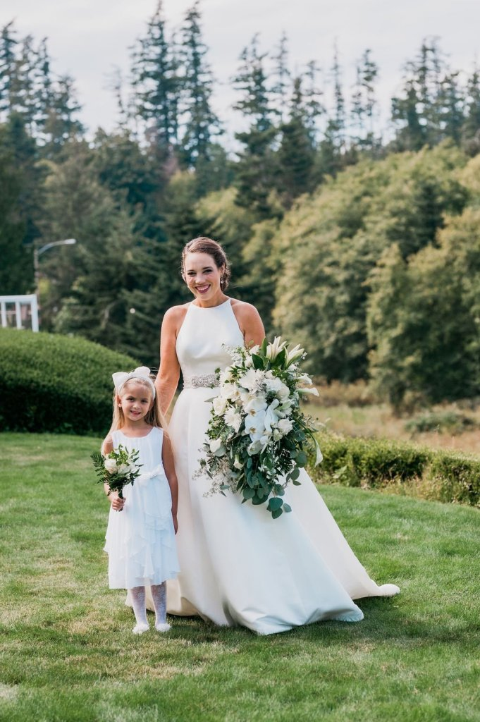 bride with flower girl, white and green wedding, classic wedding dress, high neckline wedding dress, a line wedding dress
