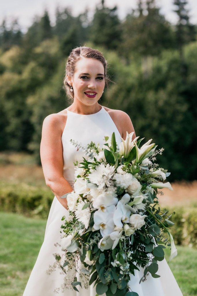 bridal wedding portrait, green and white bouquet, lilies, roses, orchids, cascade bouquet