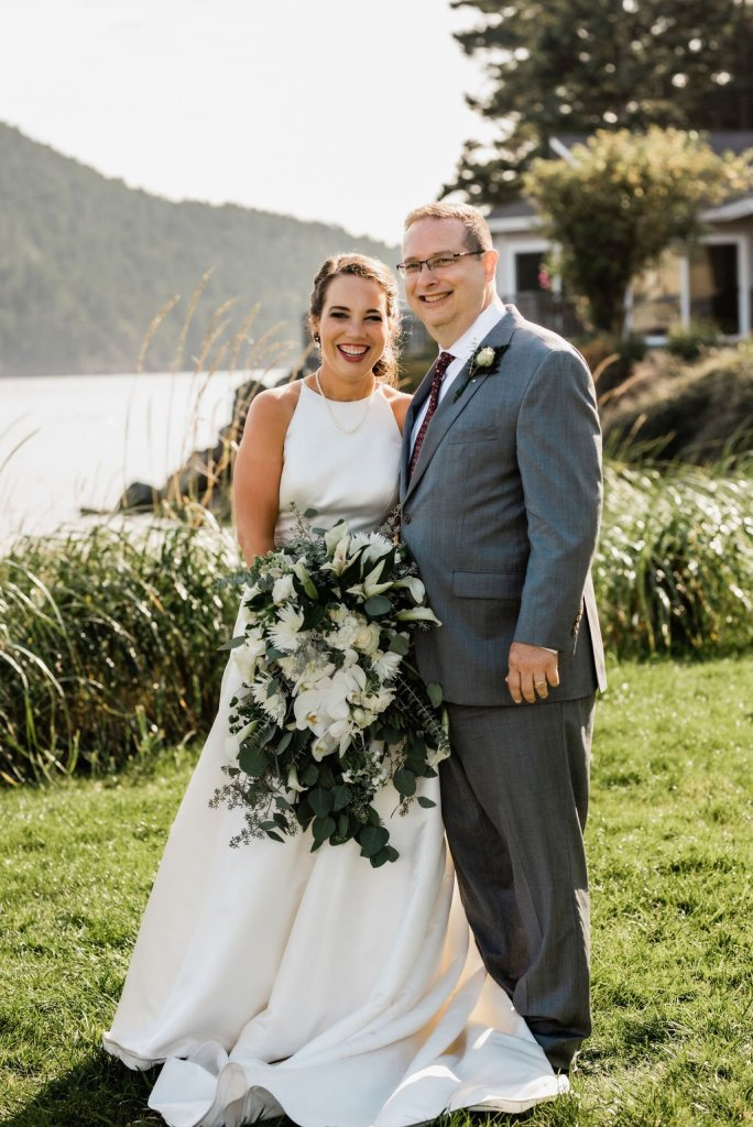 father of the bride and bride photo, classic wedding dress, classic gray suit, beach wedding