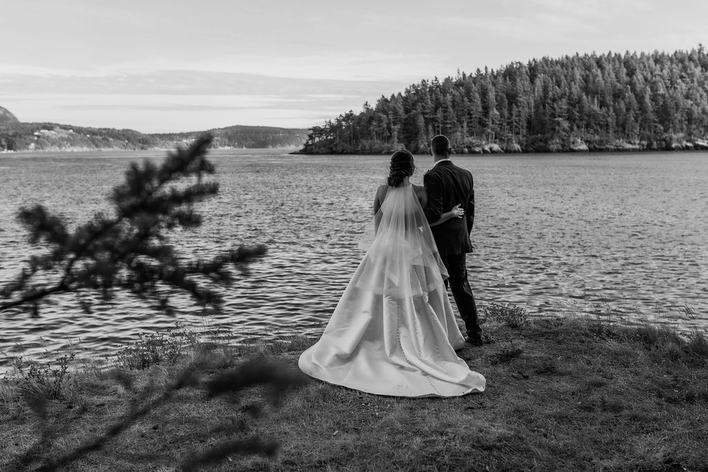 bride and groom wedding portrait, black and white wedding photography, bride and groom looking out over water and islands at Pacific Northwest wedding portrait photography