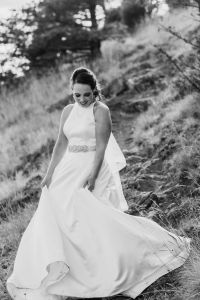 bride on mountain trail twirling in dress, classic a line wedding dress with beading and fingertip veil, black and white wedding photography