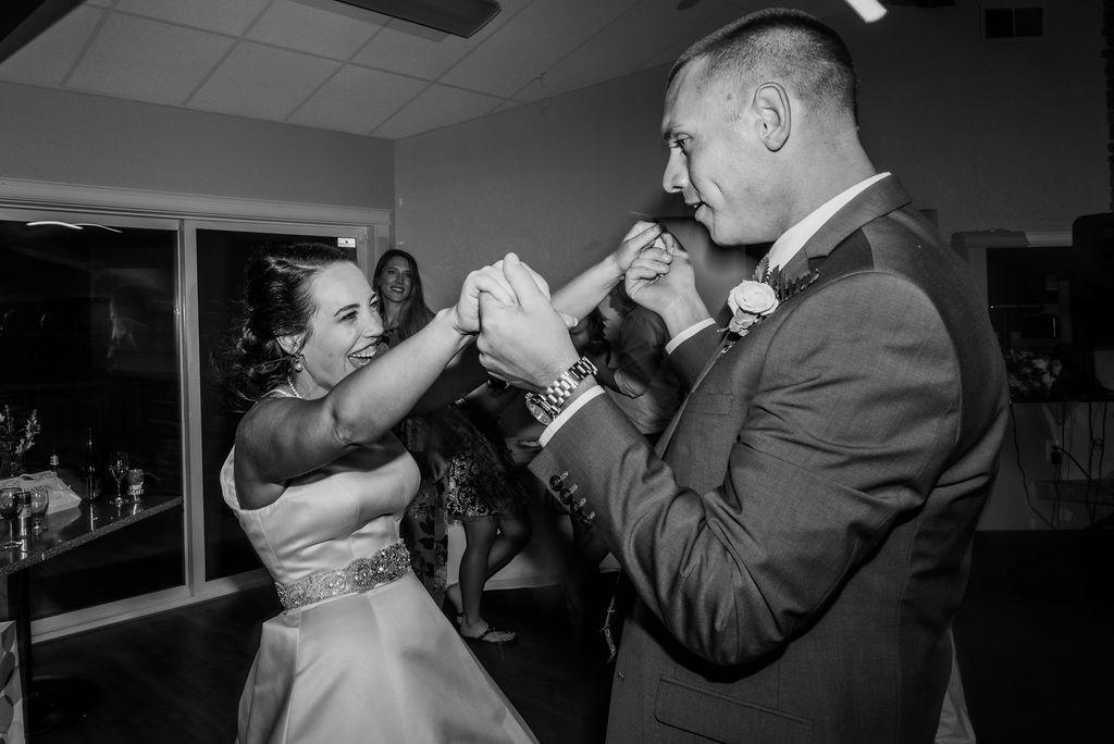 bride excitedly embracing groom