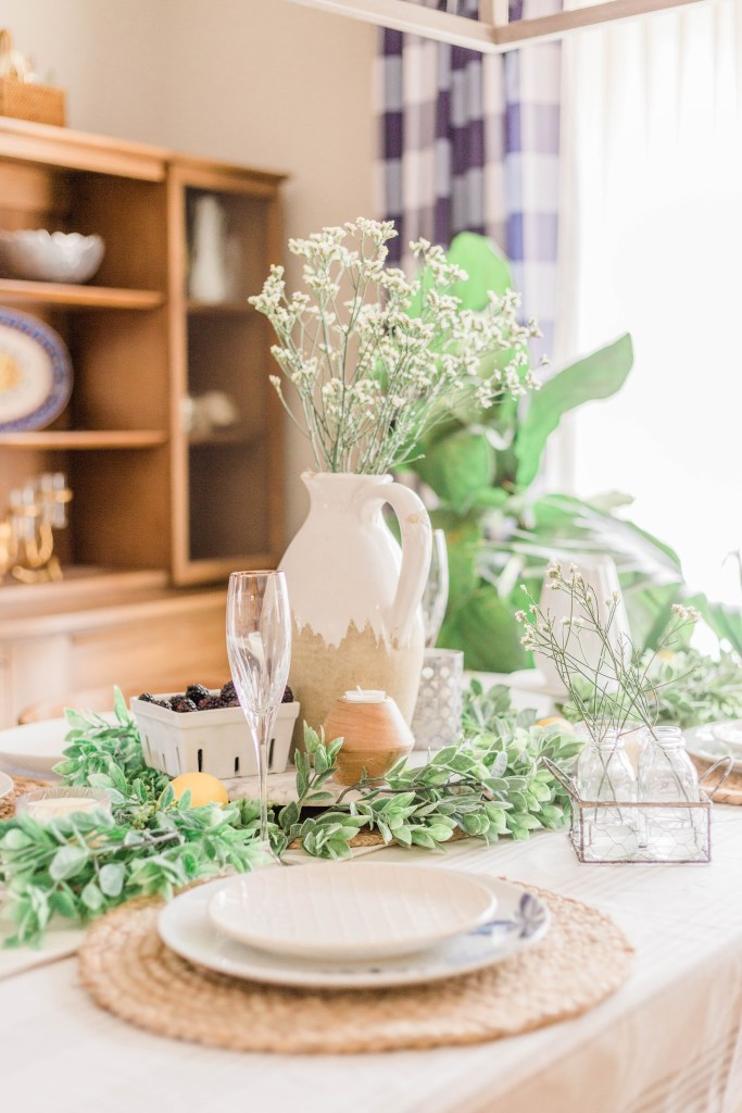 simple elegant spring tablescape design ideas neutral greenery lemons white blue yellow and green