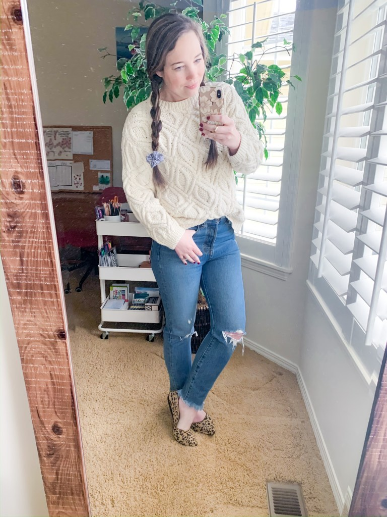 Work from home outfits that are casual and comfortable while still looking good! Woman in jeans, flats and cable knit cozy sweater.