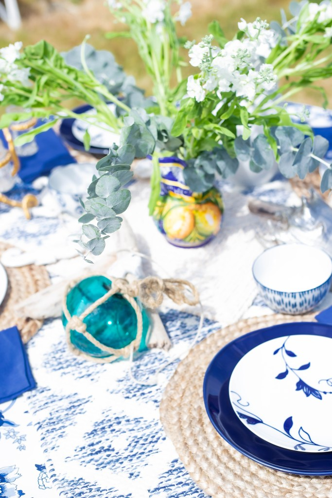beautiful summer white, blue and gold tablescape. making the everyday a celebration. Japanese glass buoy.