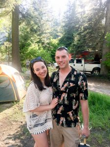 Couple smiling while camping