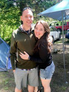 Couple smiling in campsite