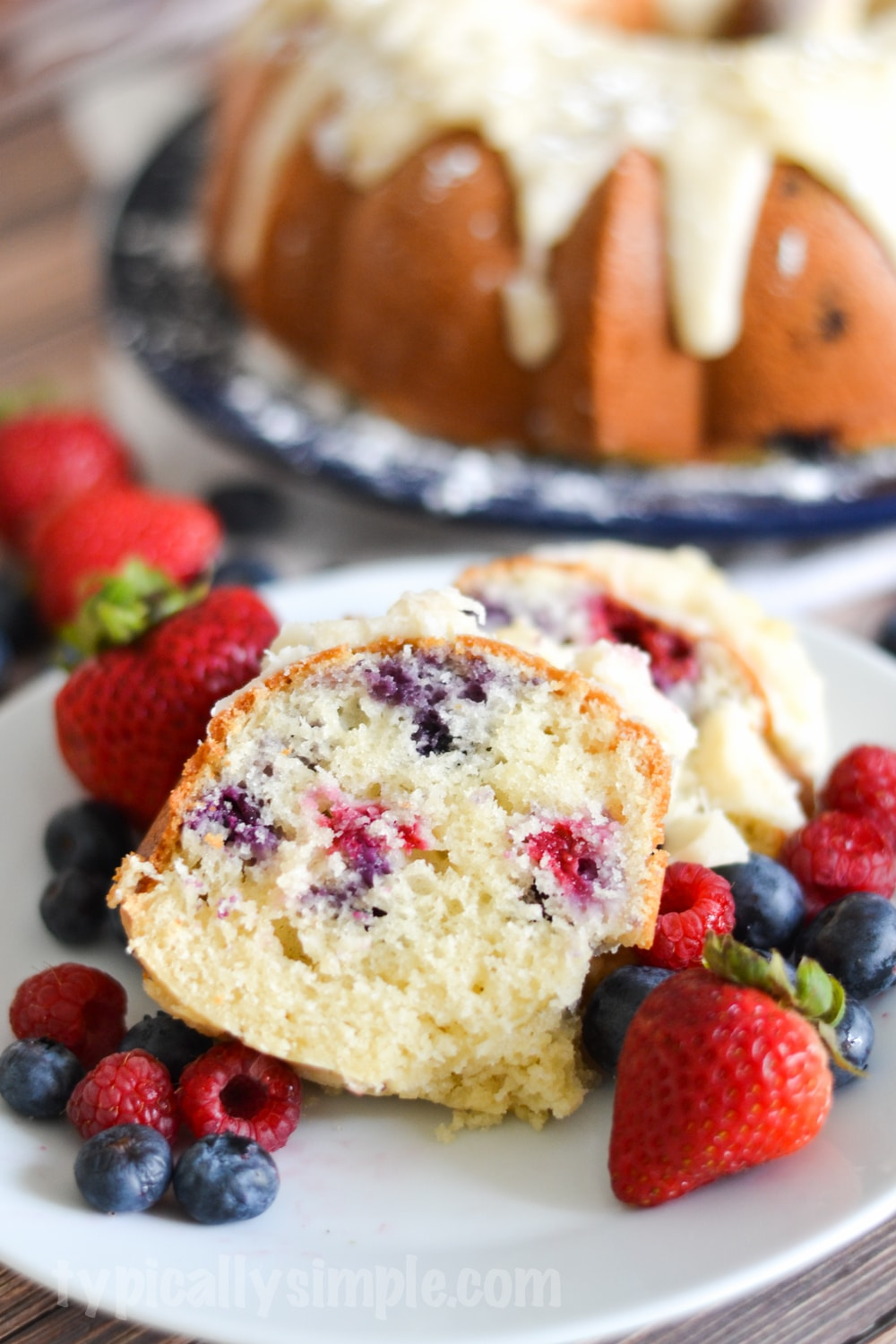 A decadent berry bundt cake recipe that is quite simple to make using fresh blueberries and raspberries. A delicious treat to serve with after dinner coffee!