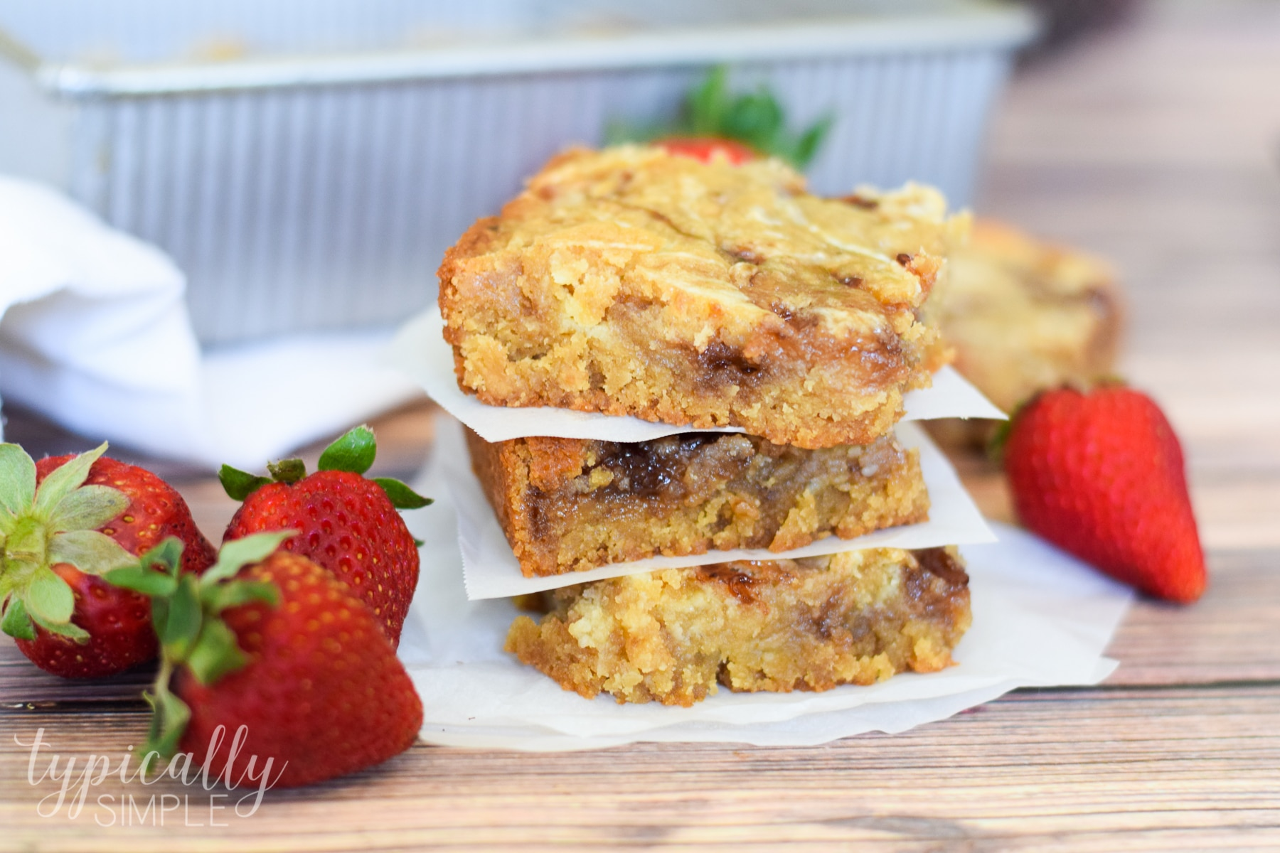 These strawberry swirl cheesecake blondie bars are a decadent treat that is quite easy to make. With some basic baking ingredients and a few minutes of prep, this will quickly become your new go-to dessert to make for parties!