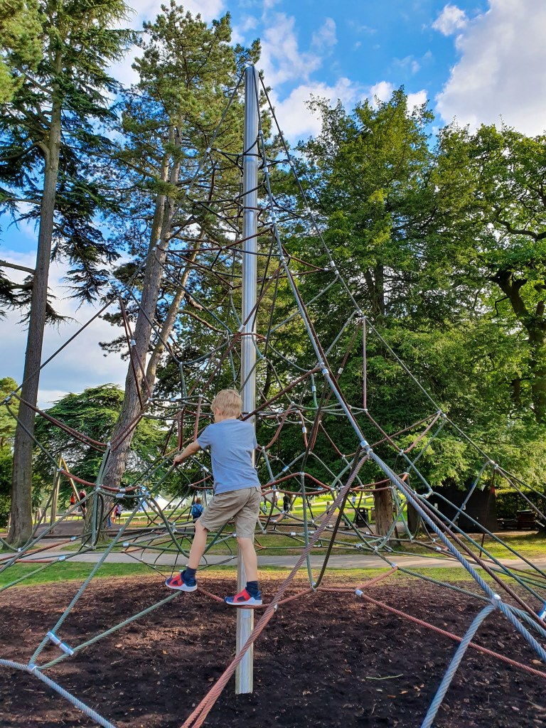 Boy climbing the Web Apparatus at Trentham Gardens