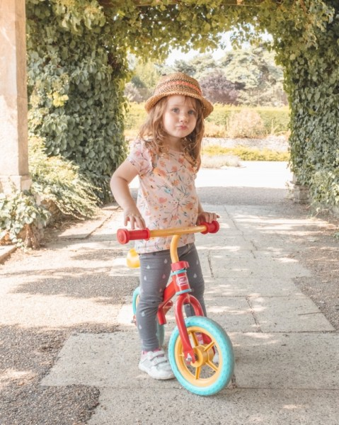 Image of a young girl on a bike wearing a hat in Norwich