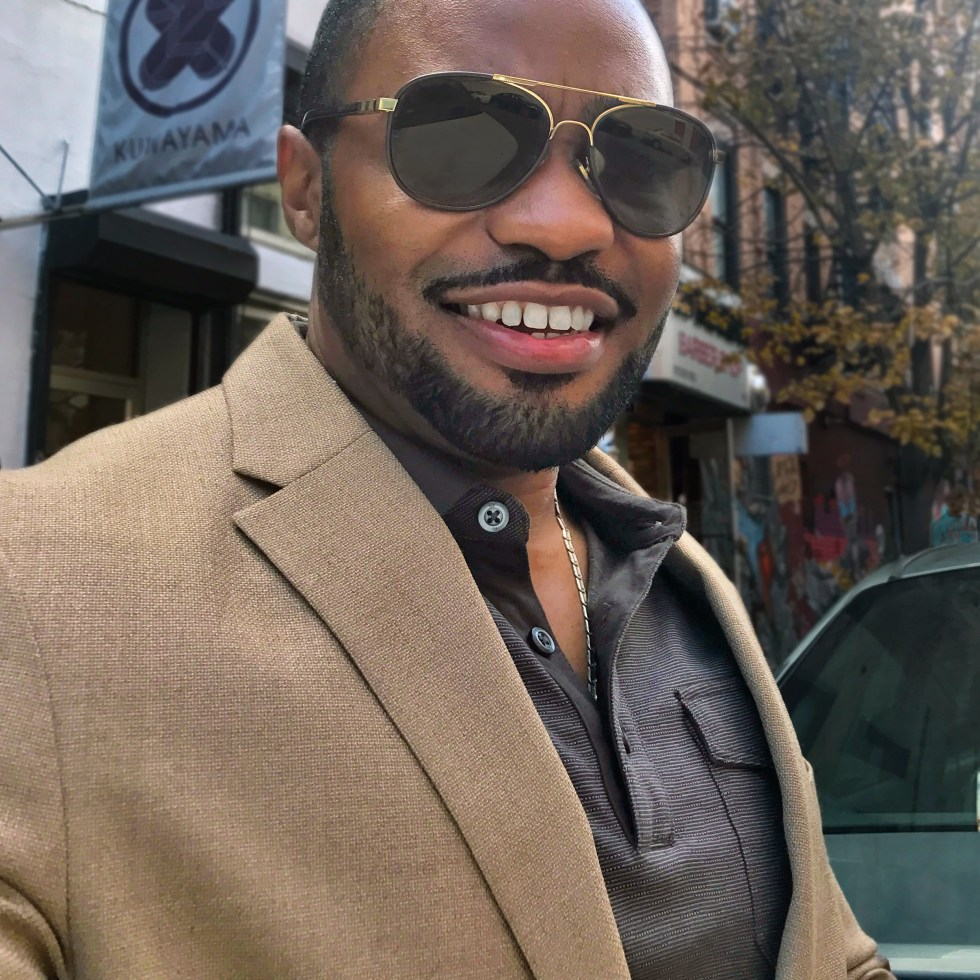 East village capture of celebrity music producer Tyrone Smith in Tommy Hilfiger and Louis Vuitton