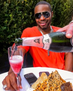 1 person, Tyrone Smith, Gruet wine, Diesel, Theory, musician, producer, composer, and sunglasses
