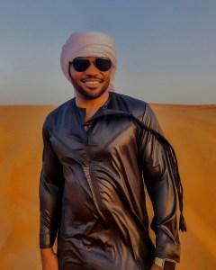 Al Hatta Desert UAE Dubai Tyrone Smith wearing Louis Vuitton shades jalabiya