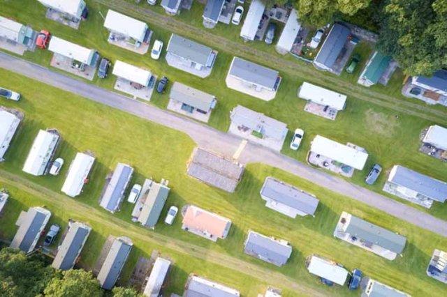 Caravan site park aerial view illuminated by summer sun uk