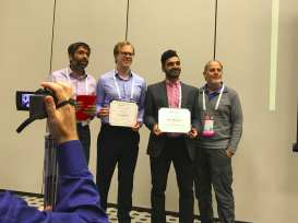 Hamed Rahimian receiving the INFORMS Computing Society Student Paper Prize Runner-up, 2017