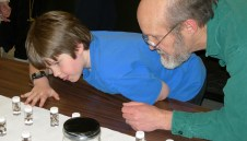 Tom Hetherington and son examine bugs in goo at the Triplehorn Insect Collection. 2007