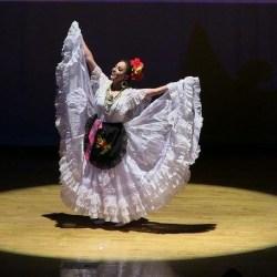 Maria Patiño dons a white dress for the state of Veracruz, Mexico during a performance (photo courtesy Maria Patiño).