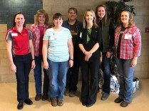 Several women from Coshocton County attended the event. Six of the nine women are pictured here with educator Emily Adams.