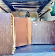 Truck almost full. The shorter cabinets were placed in front of the taller ones for safety.