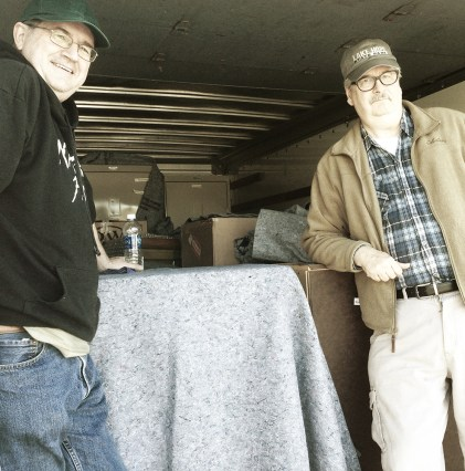Dave Parshall (right) with Norman Johnson, after his collection was loaded up on the moving truck.