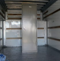 The tall metal cabinets were the first ones to be moved into the truck.