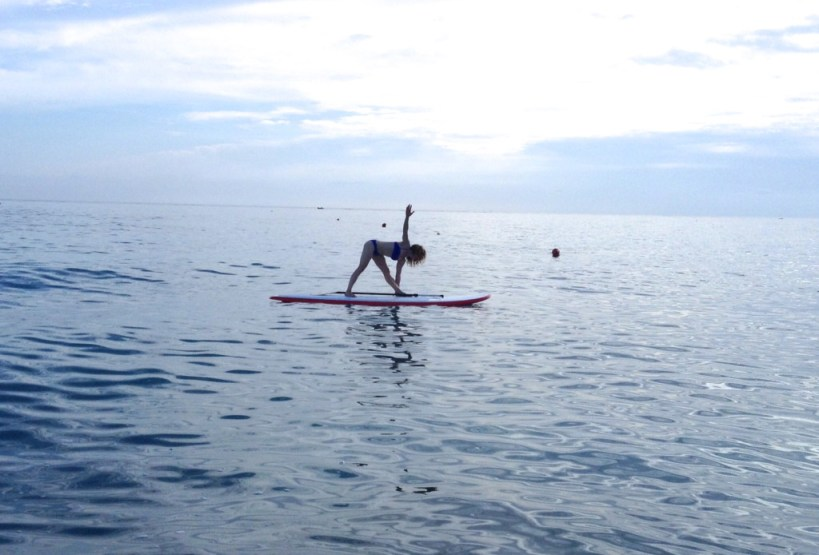 Luci Gabel, Triangle Pose Yoga on Paddleboard
