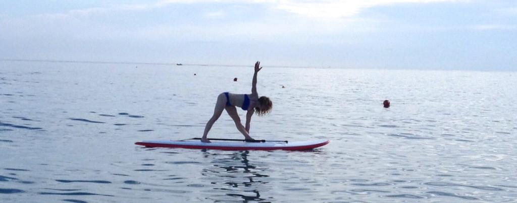 Luci Gabel, Triangle Pose Yoga on Paddleboard