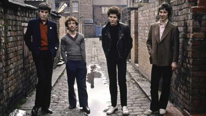 UNITED KINGDOM - JANUARY 01: Photo of BUZZCOCKS and Pete SHELLEY and John MAHER and Steve DIGGLE and Steve GARVEY; Posed group portrait -L-R John Maher, Pete Shelley, Steve Garvey and Steve Diggle, (Photo by Fin Costello/Redferns)