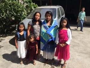 Monica with her mother and 3 younger sisters after her baptism.