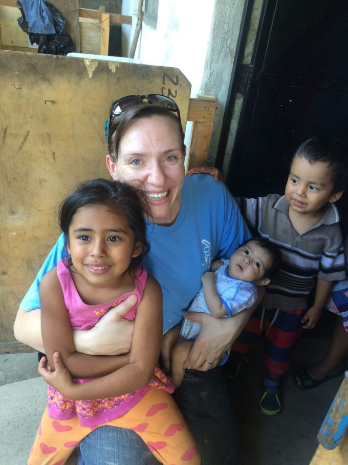 Missy loving on some of the kids in a family we serve.