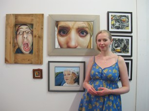 Rachael Berry with her paintings