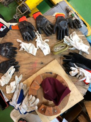 Warm waterproof gloves with liners. Gloves and or liners are frequently changed out during long moorings.
