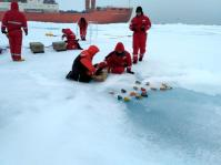 Deploying the boats with the help of Physical Oceanographer Myriel Horn. I'm in the orange, Myriel is on the right. (photo by Vladimir Bogdanov)