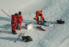 Taking out the ice core (photo by Ben Rabe).