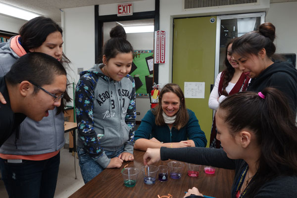"Under Hauri's guidance, high school students perform an ""ocean acidification in a cup"" experiment during Bering Sea Days in St. Paul, Alaska. (Photo by P. Freeman)"