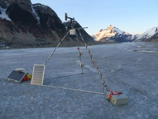 Instruments on an icefield near mountains