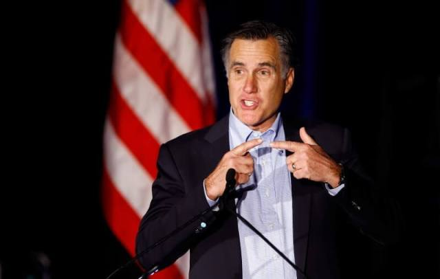 Former presidential candidate Mitt Romney speaks at the Republican National Committee winter meetings in San Diego, California January 16, 2015. REUTERS/Mike Blake
